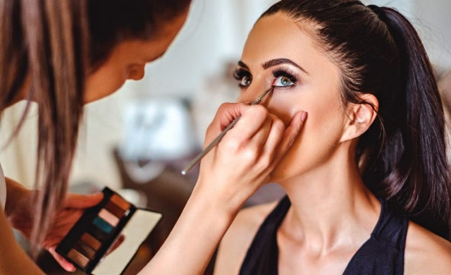Image Showing A Professional Makeup Artist Doing Makeup For A Customer In Her Beauty Salon