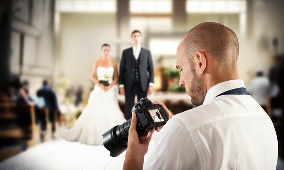 Image Showing A Close-Up View Of A Man Staring an image in his camera During Wedding Function