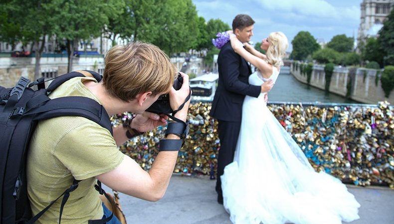 Image Showing A Professional Wedding Photographer Taking Pictures In A Wedding Photo shot
