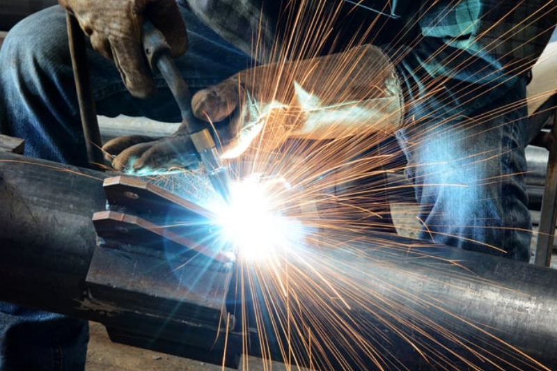 An Image of A Male Welder Working In A Metal Fabrication Company