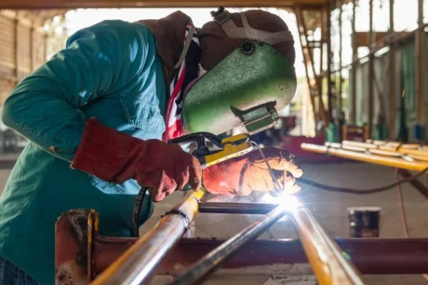 A Welder Works In Metal Construction In A Metal Fabrication Company.